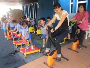 K2 children and their teachers are exercising together